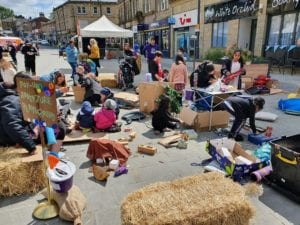 The children of Accrington knew exactly what to do with all the loose parts at this pop-up adventure playground, even if the adults were a bit unsure. After a slow start, the site was bustling, and it was particularly interesting to have the festival going on in the background. It was funny that for the majority of the time, the children ignored the music - they were deep into their play and nothing much brought them out of their own adventures. Occasionally a catchy phrase in a song could take their attention - they would lift their heads briefly, sing along, and then dive right back into play.